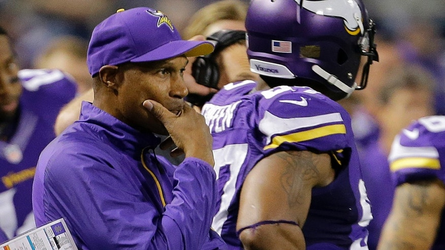 Minnesota Vikings head coach Leslie Frazier watches from the sideline in the first half of an NFL football game against the Green Bay Packers, Sunday, Oct. 27, 2013, in Minneapolis. (AP Photo/Ann Heisenfelt)