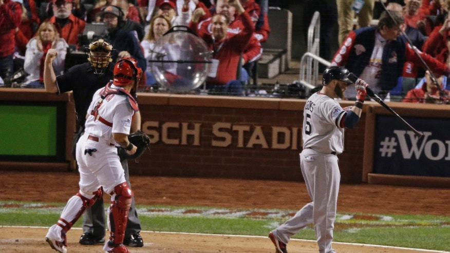 Boston Red Sox's Jonny Gomes (5) reacts after striking out to end the top of the sixth inning of Game 5 of baseball's World Series against the St. Louis Cardinals Monday, Oct. 28, 2013, in St. Louis. (AP Photo/Charlie Riedel)