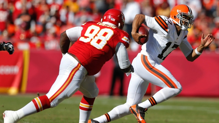Cleveland Browns quarterback Jason Campbell (17) gets around Kansas City Chiefs defensive tackle Anthony Toribio (98) during the first half of an NFL football game in Kansas City, Mo., Sunday, Oct. 27, 2013. (AP Photo/Ed Zurga)