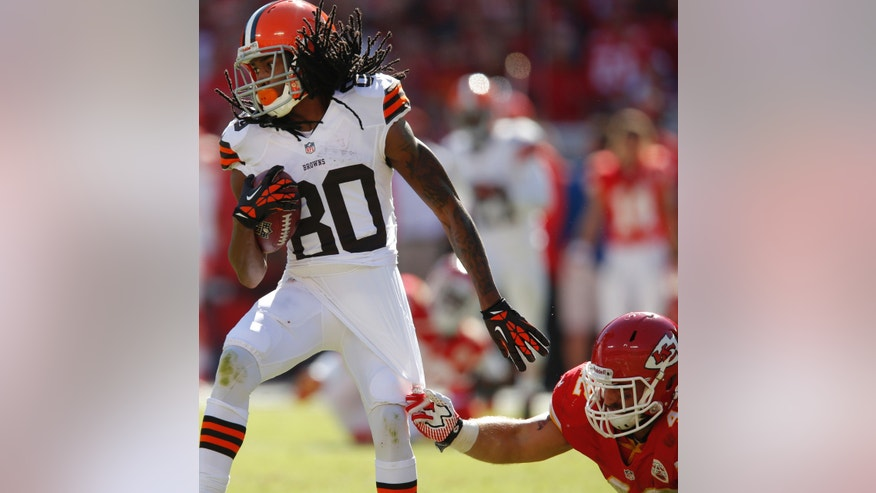 Cleveland Browns wide receiver Travis Benjamin (80) breaks away from Kansas City Chiefs free safety Bradley McDougald (48) during the second half of an NFL football game in Kansas City, Mo., Sunday, Oct. 27, 2013. (AP Photo/Ed Zurga)