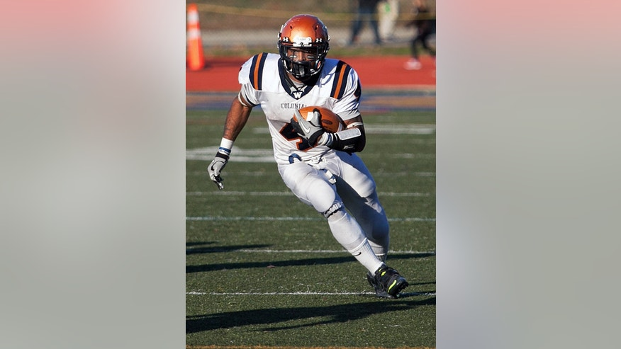 In this photo provided by Worcester State University, Western Connecticut State running back Octavias McKoy runs the ball against Worcester State during an NCAA college Division III football game in Worcester, Mass., Saturday, Oct. 26, 2013. McKoy ran for 455 yards, setting an NCAA record for all-divisions, while defeating Worcester State 55-35 on Saturday. (AP Photo/Worcester State University, Matt Wright)