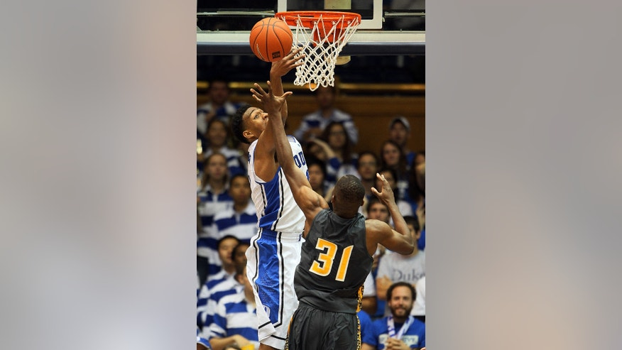 Duke's Jabari Parker (1) blocks the shot of Bowie State's David Golladay (31) during the second half of an exhibition NCAA college basketball game in Durham, N.C., Saturday, Oct. 26, 2013. Duke won 103-67. (AP Photo/Karl B DeBlaker)