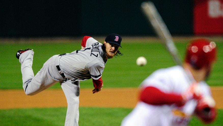 Boston Red Sox starting pitcher Clay Buchholz throws during the first inning of Game 4 of baseball's World Series against the St. Louis Cardinals  Sunday, Oct. 27, 2013, in St. Louis. (AP Photo/Jeff Curry, Pool)