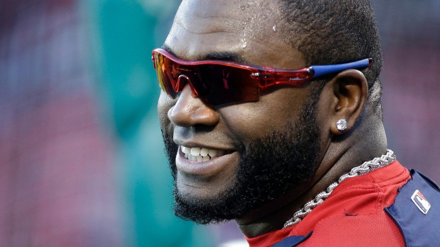 Boston Red Sox's David Ortiz smiles during batting practice before Game 4 of baseball's World Series against the St. Louis Cardinals Sunday, Oct. 27, 2013, in St. Louis. (AP Photo/David J. Phillip)