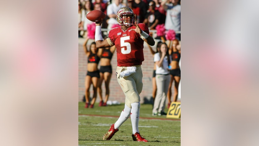 Florida State quarterback Jameis Winston (5) throws in the second quarter of an NCAA college football game against North Carolina State, Saturday, Oct. 26, 2013, in Tallahassee, Fla. (AP Photo/Phil Sears)
