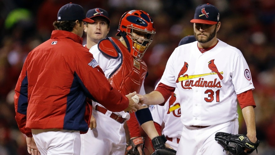 St. Louis Cardinals manager Mike Matheny takes starting pitcher Lance Lynn out of the game during the sixth inning of Game 4 of baseball's World Series against the Boston Red Sox Sunday, Oct. 27, 2013, in St. Louis. (AP Photo/Jeff Roberson)