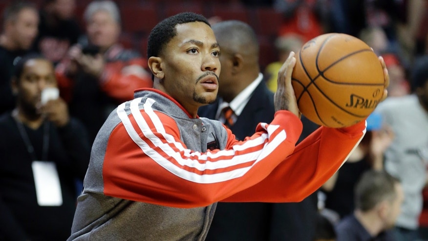 Chicago Bulls guard Derrick Rose warms up before an NBA preseason basketball game against the Denver Nuggets in Chicago on Friday, Oct. 25, 2013. (AP Photo/Nam Y. Huh)