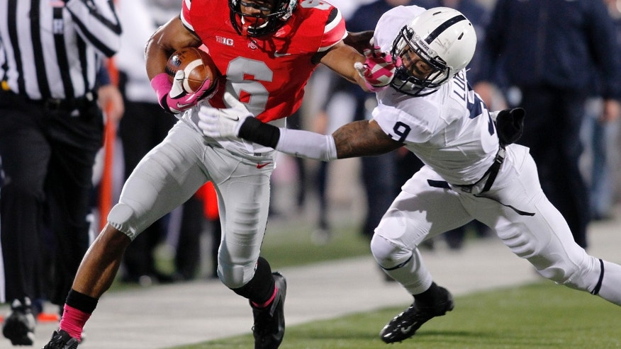 FILE - In this Oct. 26, 2013 file photo, Ohio State wide receiver Evan Spencer, (6) is tackled by Penn State cornerback Jordan Lucas during the second quarter of an NCAA college football game in Columbus, Ohio. With four games remaining, including Saturday's contest at Purdue, No. 4 Ohio State gears up for a race to the finish in the Big Ten and national championship races. (AP Photo/Paul Vernon, File)