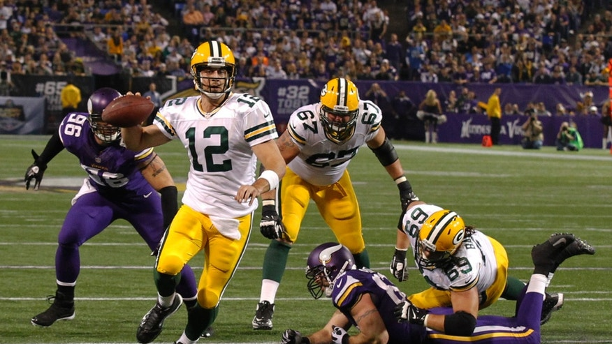 Green Bay Packers quarterback Aaron Rodgers (12) runs toward the end zone in the second half of an NFL football game against the Minnesota Vikings, Sunday, Oct. 27, 2013, in Minneapolis. (AP Photo/Ann Heisenfelt)
