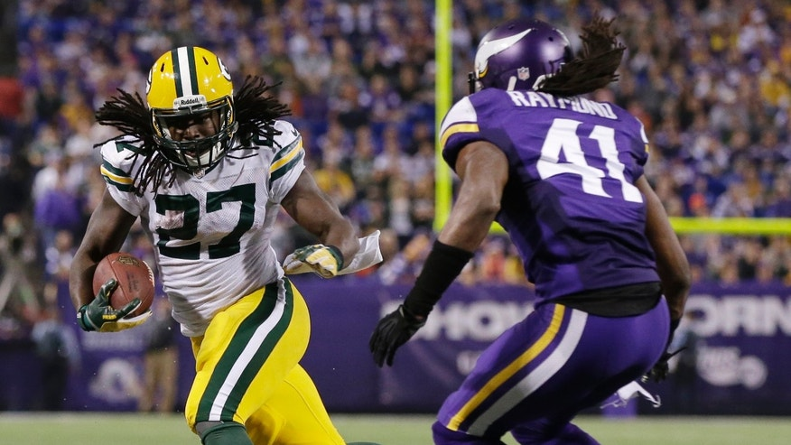 Green Bay Packers running back Eddie Lacy (27) rushes against Minnesota Vikings strong safety Mistral Raymond (41) in the second half of an NFL football game, Sunday, Oct. 27, 2013, in Minneapolis. (AP Photo/Jim Mone)