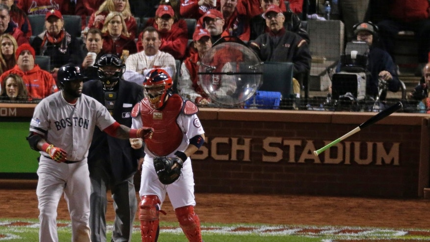 Boston Red Sox's David Ortiz tosses his bat after being walked during the sixth inning of Game 4 of baseball's World Series against the St. Louis Cardinals Sunday, Oct. 27, 2013, in St. Louis. (AP Photo/Charlie Riedel)