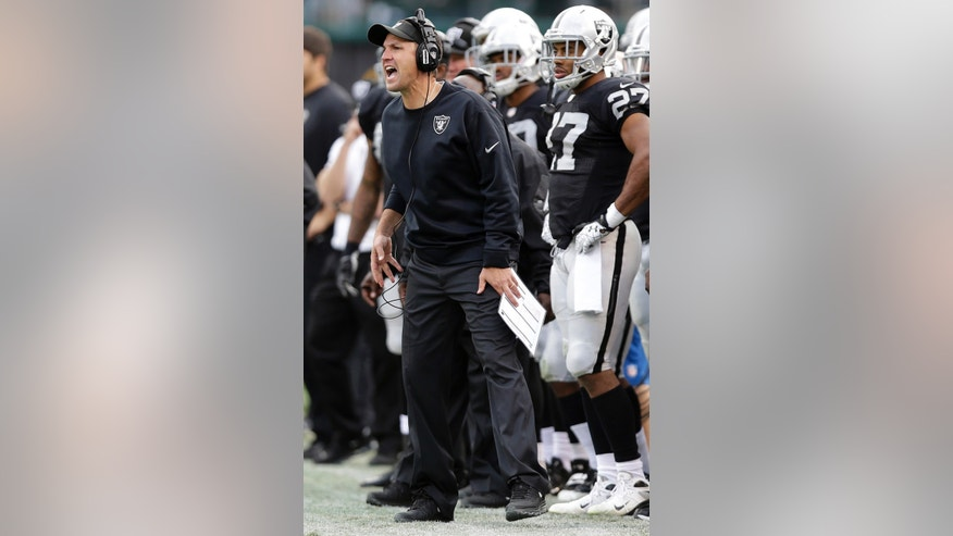 Oakland Raiders head coach Dennis Allen yells from the sideline during the second quarter of an NFL football game against the Pittsburgh Steelers in Oakland, Calif., Sunday, Oct. 27, 2013. (AP Photo/Marcio Jose Sanchez)