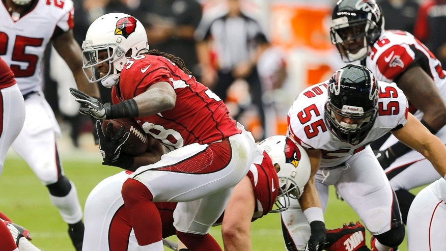 Arizona Cardinals running back Andre Ellington, left, breaks free for a touchdown as Atlanta Falcons outside linebacker Paul Worrilow (55) defends during the first half of an NFL football game Sunday, Oct. 27, 2013, in Glendale, Ariz. (AP Photo/Rick Scuteri)