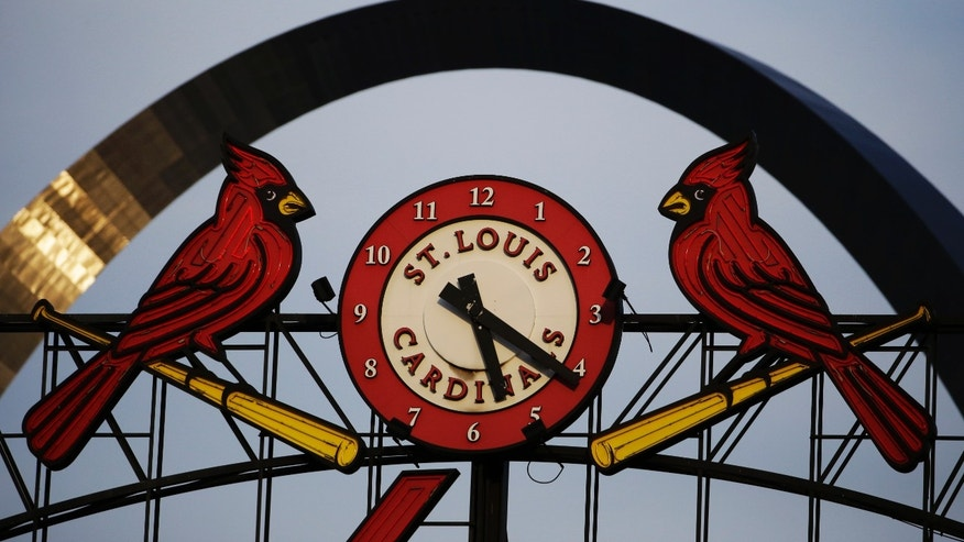 The Gateway Arch sits behind the clock at Busch Stadium before Game 5 of baseball's World Series between the St. Louis Cardinals and the Boston Red Sox, Monday, Oct. 28, 2013, in St. Louis. (AP Photo/Matt Slocum)