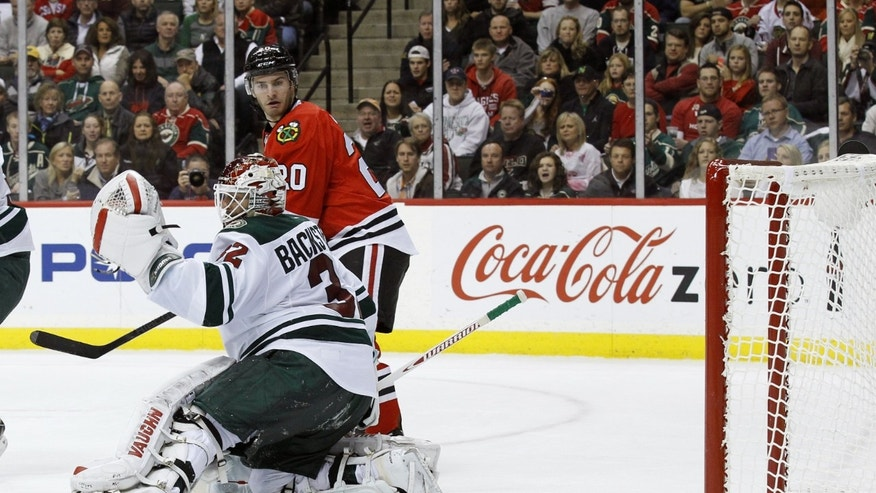 Chicago Blackhawks left wing Brandon Saad (20) watches as a shot by  Blackhawks defenseman Nick Leddy gets past Minnesota Wild goalie Niklas Backstrom (32) of Finland for a goal during the second period of an NHL hockey game in St. Paul , Minn., Monday, Oct. 28, 2013. (AP Photo/Ann Heisenfelt)