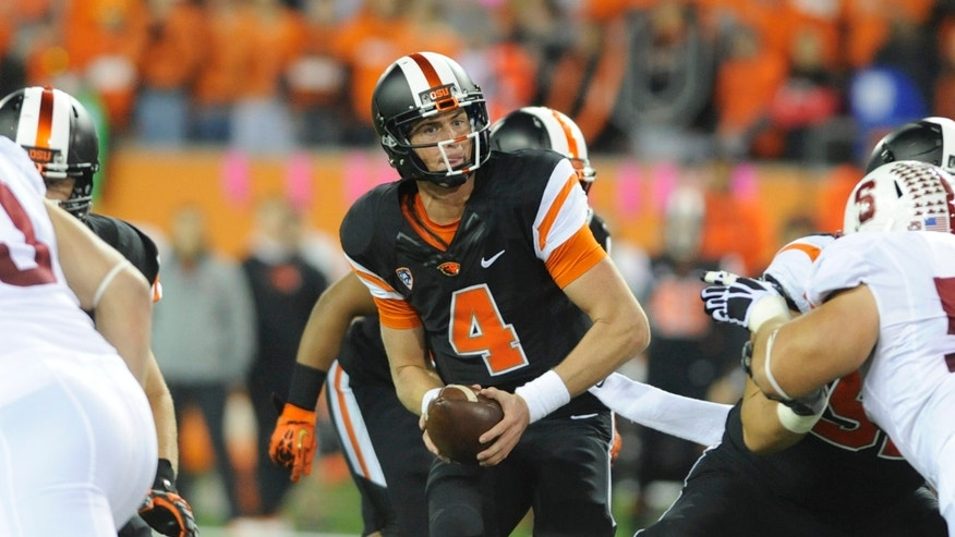 Oregon State's quarterback Sean Mannion (4) looks to pass against Stanford during the first half of an NCAA college football game in Corvallis, Ore., Saturday Oct. 26, 2013. Stanford beat Oregon State 20-12. (AP Photo/Greg Wahl-Stephens)