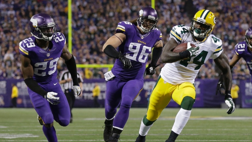 Green Bay Packers running back James Starks (44) runs against Minnesota Vikings cornerback Xavier Rhodes (29) and defensive end Brian Robison (96) for a touchdown in the second half of an NFL football game, Sunday, Oct. 27, 2013, in Minneapolis. (AP Photo/Jim Mone)