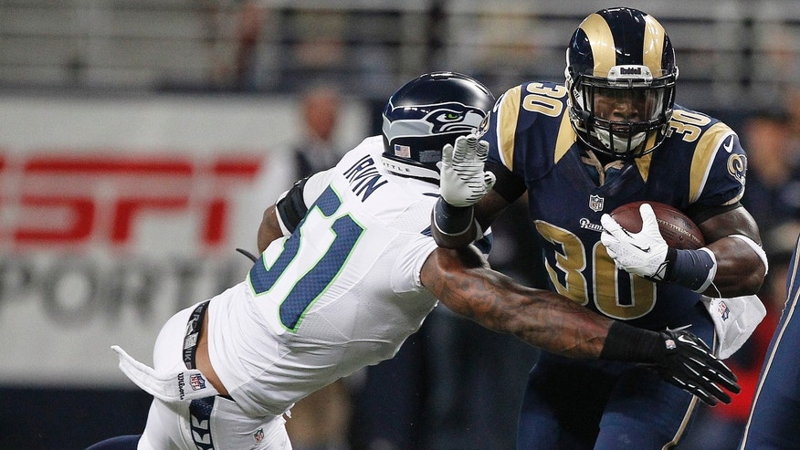 St. Louis Rams running back Zac Stacy (30) rushes against Seattle Seahawks outside linebacker Bruce Irvin (51) during the first half of an NFL football game, Monday, Oct. 28, 2013, in St. Louis. (AP Photo/Kiichiro Sato)