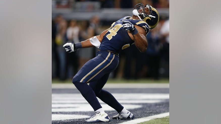 St. Louis Rams defensive end Robert Quinn (94) celebrates after sacking Seattle Seahawks quarterback Russell Wilson (3) during the first half of an NFL football game, Monday, Oct. 28, 2013, in St. Louis. (AP Photo/Michael Conroy)