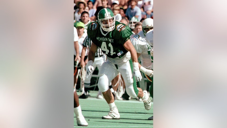 FILE - In this Dec. 26, 1989, file photo, Michigan State's Charles Bullough (41) chases a play during the Aloha Bowl NCAA college football game against Hawaii in Honolulu, Hawaii. With a family history at Michigan State that stretches back decades, linebacker Max Bullough can provide a unique perspective on this week's showdown with rival Michigan. Max's grandfather, father and two uncles, including Charles, played for the Spartans.  (AP Photo/Barry Sweet, File)
