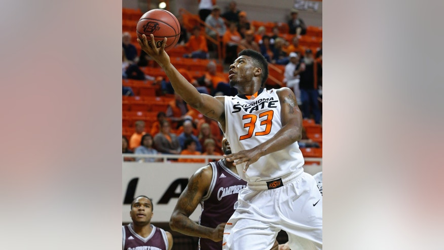 Oklahoma State guard Marcus Smart (33) shoots in front of Campbellsville forward A'Darius Pegues in the first half of an NCAA college  exhibition basketball game in Stillwater, Okla., Sunday, Oct. 27, 2013. (AP Photo/Sue Ogrocki)