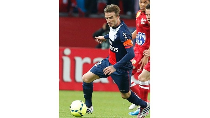 May 18, 2013: In this photo, Paris Saint Germain&#39&#x3b;s David Beckham dribbles the ball during a French League One soccer match against Brest at Parc des Princes Stadium in Paris.