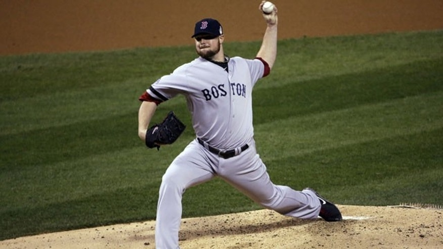 October 28, 2013: Boston Red Sox starting pitcher Jon Lester throws during the second inning of Game 5 of baseball's World Series against the St. Louis Cardinals Monday, Oct. 28, 2013, in St. Louis. (AP Photo/David J. Phillip)