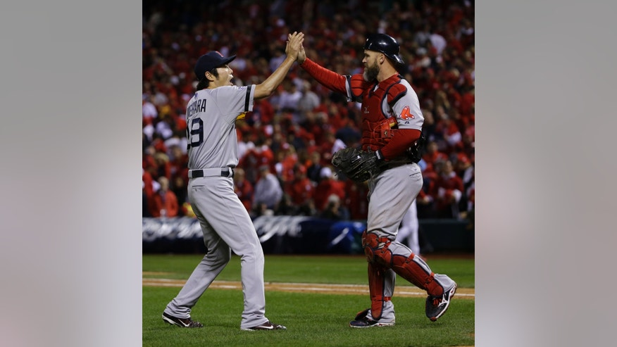 Boston Red Sox relief pitcher Koji Uehara celebrates with David Ross after St. Louis Cardinals left fielder Matt Holliday flied out to right field to end Game 5 of baseball's World Series Monday, Oct. 28, 2013, in St. Louis. The Red Sox won 3-1 to take a 3-2 lead in the series. (AP Photo/Matt Slocum)