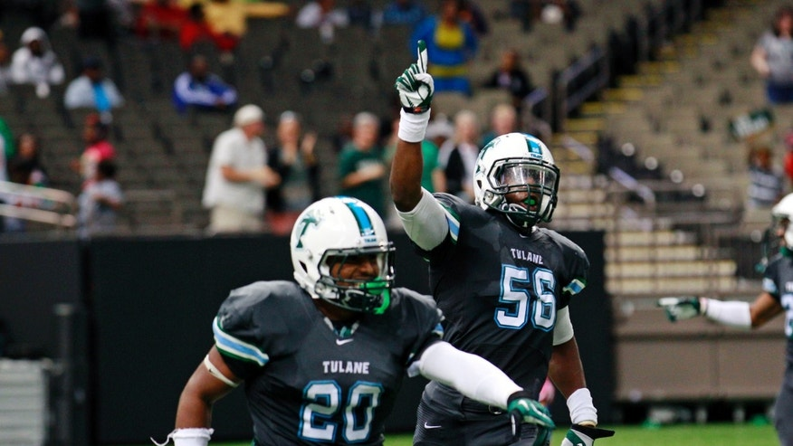 Tulane Green Wave linebacker Dominique Robertson (56) and Tulane Green Wave linebacker Nico Marley celebrate in the second half of an NCAA college football game in New Orleans, Saturday, Oct. 26, 2013. Tulane won 14-4. (AP Photo/Bill Haber)