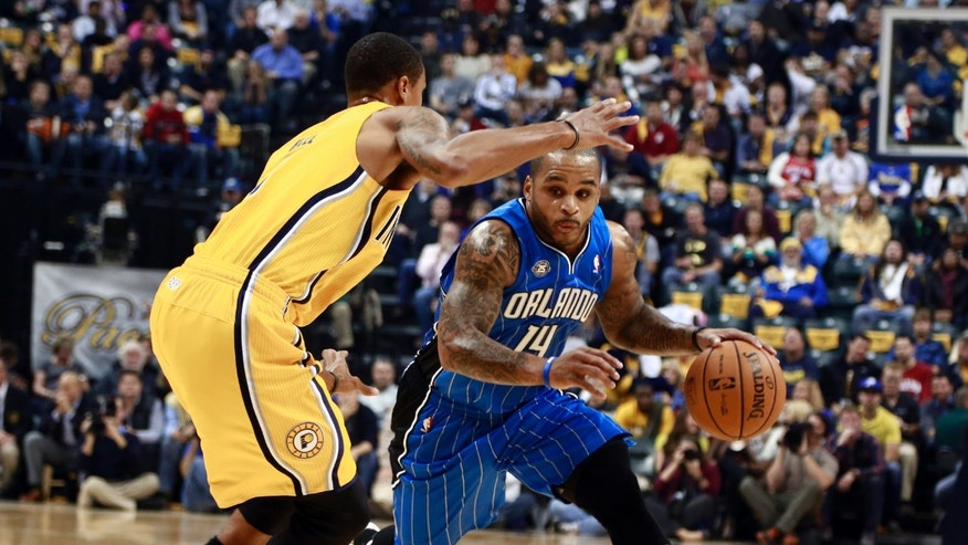 Orlando Magic guard Jameer Nelson, right, advances the basketball around Indiana Pacers guard George Hill in the first half of an NBA basketball game in Indianapolis, Tuesday, Oct. 29, 2013. (AP Photo/R Brent Smith)
