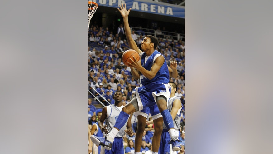 The Blue team's James Young shoots under pressure from the White team's Marcus Lee during Kentucky's NCAA college basketball scrimmage, Tuesday, Oct. 29, 2013, in Lexington, Ky. (AP Photo/James Crisp)