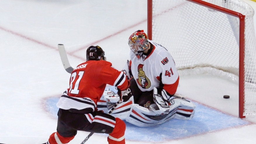 Chicago Blackhawks right wing Marian Hossa (81) scores past Ottawa Senators goalie Craig Anderson during the second period of an NHL hockey game Tuesday, Oct. 29, 2013, in Chicago. (AP Photo/Charles Rex Arbogast)
