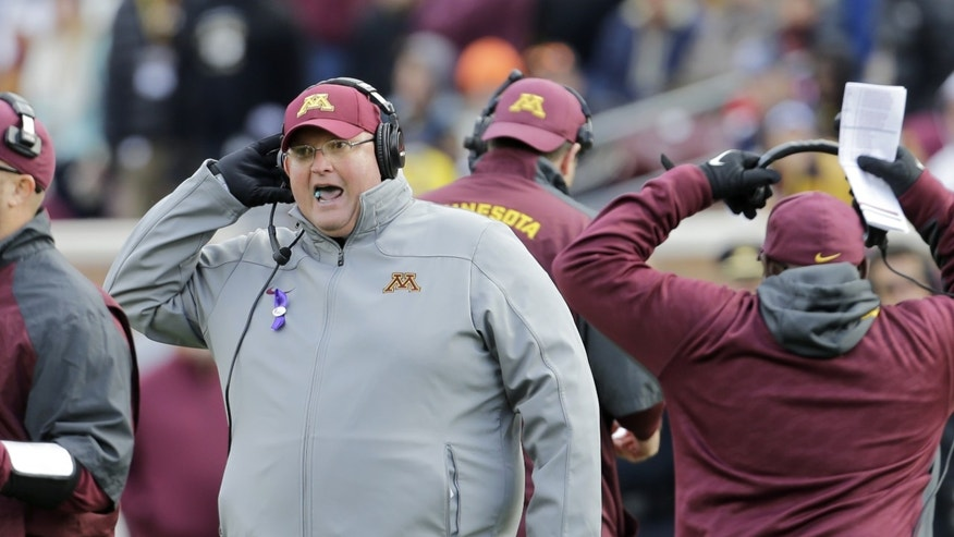 Minnesota acting head coach Tracy Claeys calls out to players during the fourth quarter of an NCAA college football game against Nebraska  in Minneapolis Saturday, Oct. 26, 2013. Minnesota beat Nebraska 34-23. (AP Photo/Ann Heisenfelt)