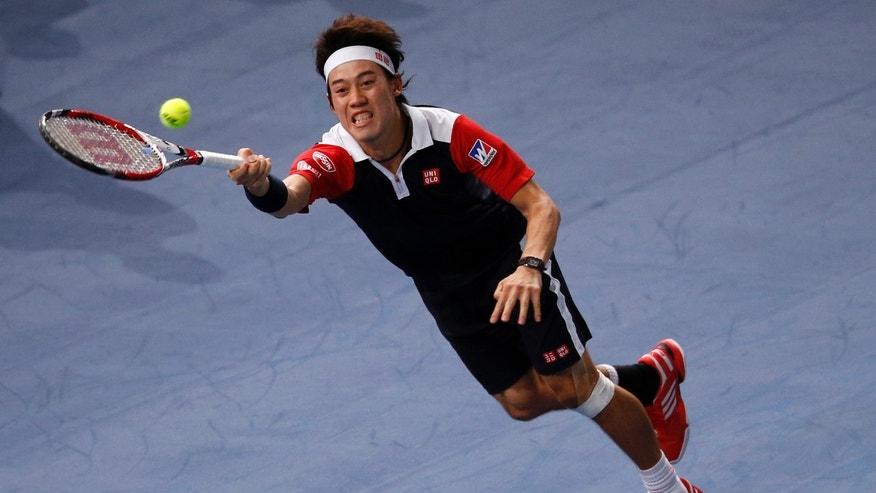 Japan's Kei Nishikori returns the ball to France's Jo-Wilfried Tsonga, during their second round match, at the Paris Masters tennis at Bercy Arena in Paris, France, Tuesday, Oct. 29, 2013. (AP Photo/Francois Mori)