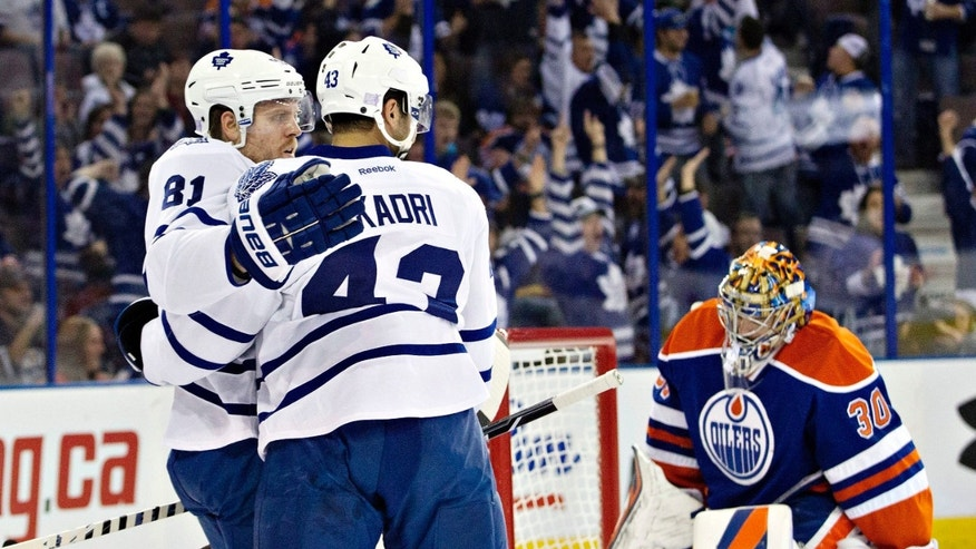 Toronto Maple Leafs winger Phil Kessel (81) and center Nazem Kadri (43) celebrate a goal as Edmonton Oilers goalie Richard Bachman (30) reacts in front of the goal during the first period of an NHL hockey game in Edmonton, Alberta, on Tuesday, Oct. 29, 2013. (AP Photo/The Canadian Press, Jason Franson)