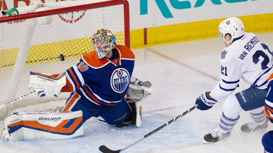 Toronto Maple Leafs winger James van Riemsdyk (21) scores a goal on Edmonton Oilers goalie Richard Bachman (30) during the second period of an NHL hockey game in Edmonton, Alberta, on Tuesday, Oct. 29, 2013. (AP Photo/The Canadian Press, Jason Franson)