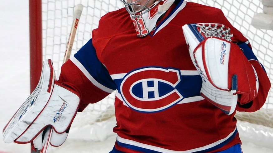 Montreal Canadiens goalie Carey Price keeps his eyes on the puck during the third period of an NHL hockey game against the Dallas Stars on Tuesday, Oct. 29, 2013, in Montreal. The Canadiens won 2-1. (AP Photo/The Canadian Press, Ryan Remiorz)
