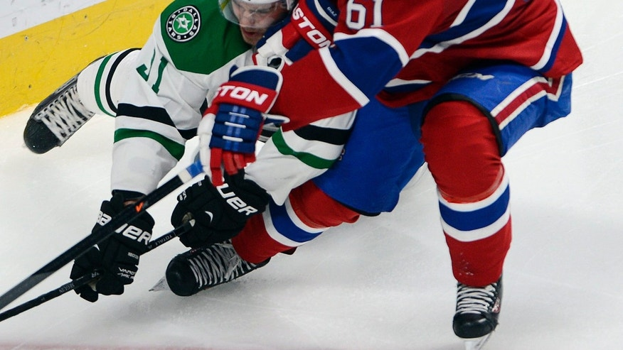 Montreal Canadiens defenseman Raphael Diaz (61) vies for the puck with Dallas Stars center Tyler Seguin (91) during the second period of an NHL hockey game Tuesday, Oct. 29, 2013, in Montreal. (AP Photo/The Canadian Press, Ryan Remiorz)
