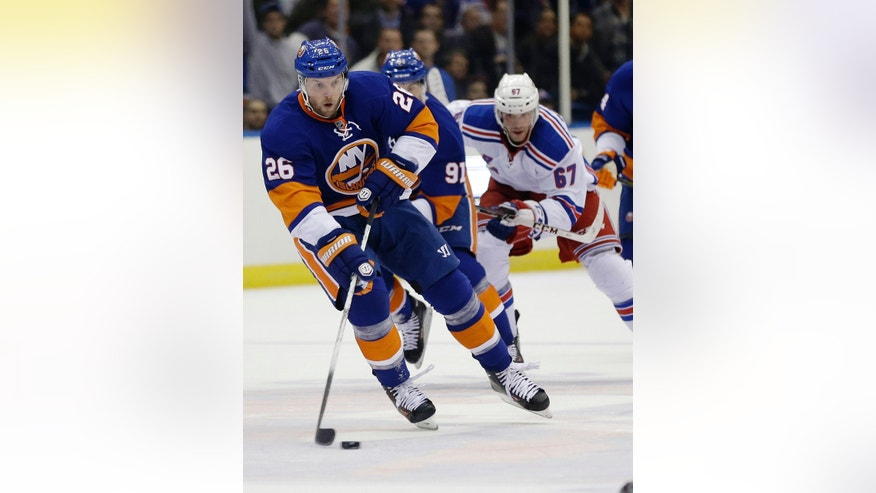 New York Islanders' Thomas Vanek (26) looks to pass during the second period of an NHL hockey game against the New York Rangers Tuesday, Oct. 29, 2013, in Uniondale, N.Y.  (AP Photo/Frank Franklin II)