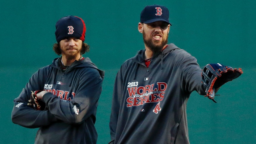 Boston Red Sox pitchers Clay Buchholz, left, and John Lackey stand together during a workout at Fenway Park in Boston, Tuesday, Oct. 29, 2013. Lackey is scheduled to start Game 6 of baseball's World Series against the St. Louis Cardinals on Wednesday in Boston. (AP Photo/Elise Amendola)