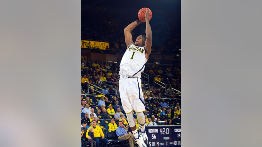 Michigan forward Glenn Robinson III (1) dunks the ball in the first half of an exhibition NCAA college basketball game against Concordia, at Crisler Center in Ann Arbor, Mich., Tuesday, Oct. 29, 2013. (AP Photo/Tony Ding)