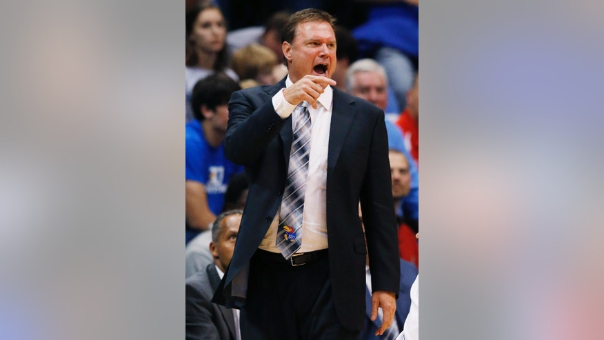 Kansas coach Bill Self shouts during the first half of an exhibition NCAA college basketball game against Pittsburg State in Lawrence, Kan., Tuesday, Oct. 29, 2013. (AP Photo/Orlin Wagner)