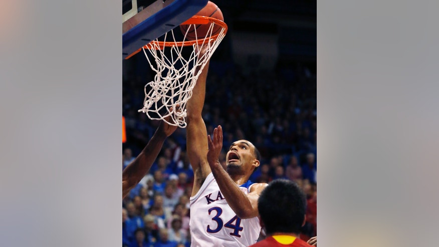 Kansas forward Perry Ellis (34) scores during the first half of an exhibition NCAA college basketball game against Pittsburg State in Lawrence, Kan., Tuesday, Oct. 29, 2013. (AP Photo/Orlin Wagner)