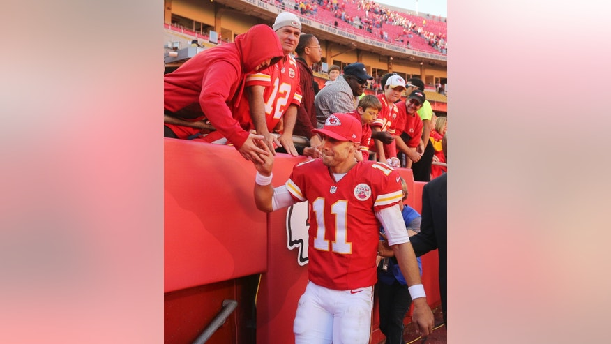 Kansas City Chiefs quarterback Alex Smith (11) is congratulated by fans following an NFL football game against the Cleveland Browns in Kansas City, Mo., Sunday, Oct. 27, 2013. The Chiefs defeated the Browns 23-17. (AP Photo/Ed Zurga)