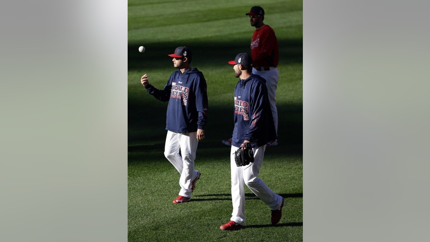 St. Louis Cardinals' Joe Kelly tosses a ball as teammate Michael Wacha watches before Game 4 of baseball's World Series against the Boston Red Sox Sunday, Oct. 27, 2013, in St. Louis. (AP Photo/Jeff Roberson)