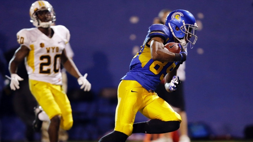 San Jose State wide receiver Chandler Jones, right, makes a touchdown reception next to Wyoming cornerback Blair Burns during the second half of an NCAA college football game on Saturday, Oct. 26, 2013, in San Jose, Calif. San Jose State won 51-44. (AP Photo/Marcio Jose Sanchez)