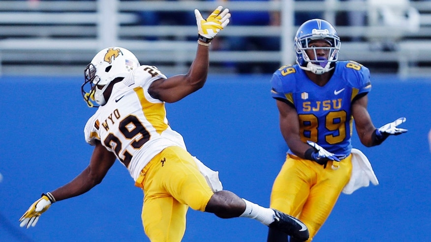 San Jose State wide receiver Chandler Jones (89) catches a 76-yard touchdown pass next to Wyoming defensive back Tim Hayes during the first half of an NCAA college football game on Saturday, Oct. 26, 2013, in San Jose, Calif. (AP Photo/Marcio Jose Sanchez)