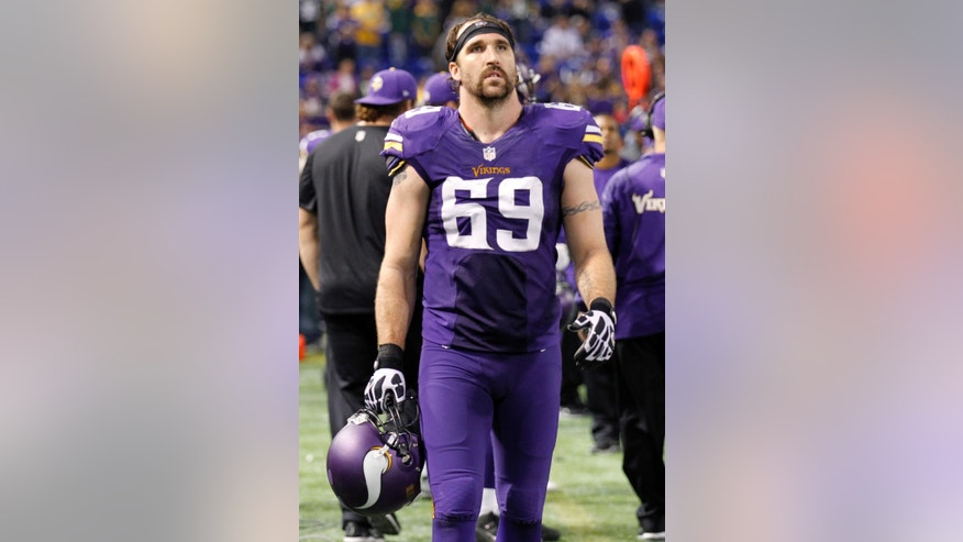 FILE - In this Oct. 27, 2013, file photo, Minnesota Vikings defensive end Jared Allen walks along the sidelines during the final minutes in the second half of an NFL football game against the Green Bay Packers in Minneapolis. Allen's name was bandied about in trade speculation until the NFL deadline passed on Tuesday afternoon, so the four-time first-team All-Pro pick will finish the final year of his contract with Minnesota. (AP Photo/Ann Heisenfelt, File)