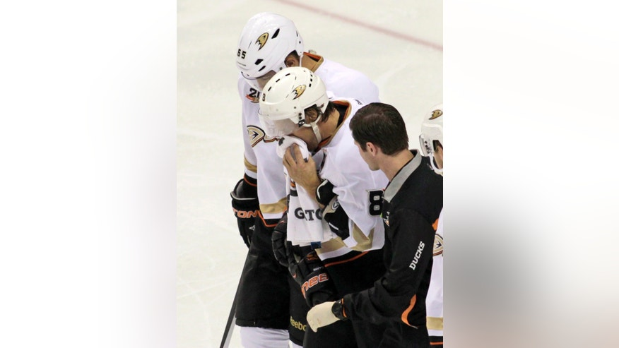 Anaheim Ducks' Teenu Selanne (8) is helped off the ice after getting  injured in the third period of an NHL hockey game against the Philadelphia Flyers, Tuesday Oct. 29, 2013, in Philadelphia.  The Ducks won 3-2. (AP Photo/H. Rumph Jr)