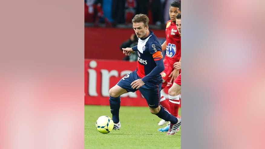 FILE - In this May 18, 2013, file photo, Paris Saint Germain's David Beckham dribbles the ball during a French League One soccer match against Brest at Parc des Princes Stadium in Paris. A person with knowledge of the situation says Beckham has chosen Miami to start a Major League Soccer franchise. The former England captain will ask the MLS to approve the ownership option in his league contract when he joined the Los Angeles Galaxy in 2007. (AP Photo/Jacques Brinon, File)